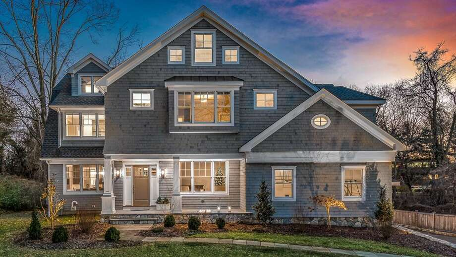 The gray custom colonial house at 62 Old Road was built about two years ago on a 0.64-acre largely level property and contains inspiring modern features.