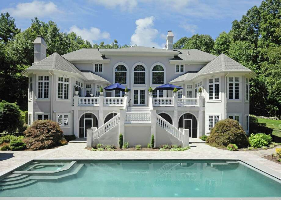 Among this home's many relaxation and entertaining features is the heated Gunite in-ground swimming pool and spa.