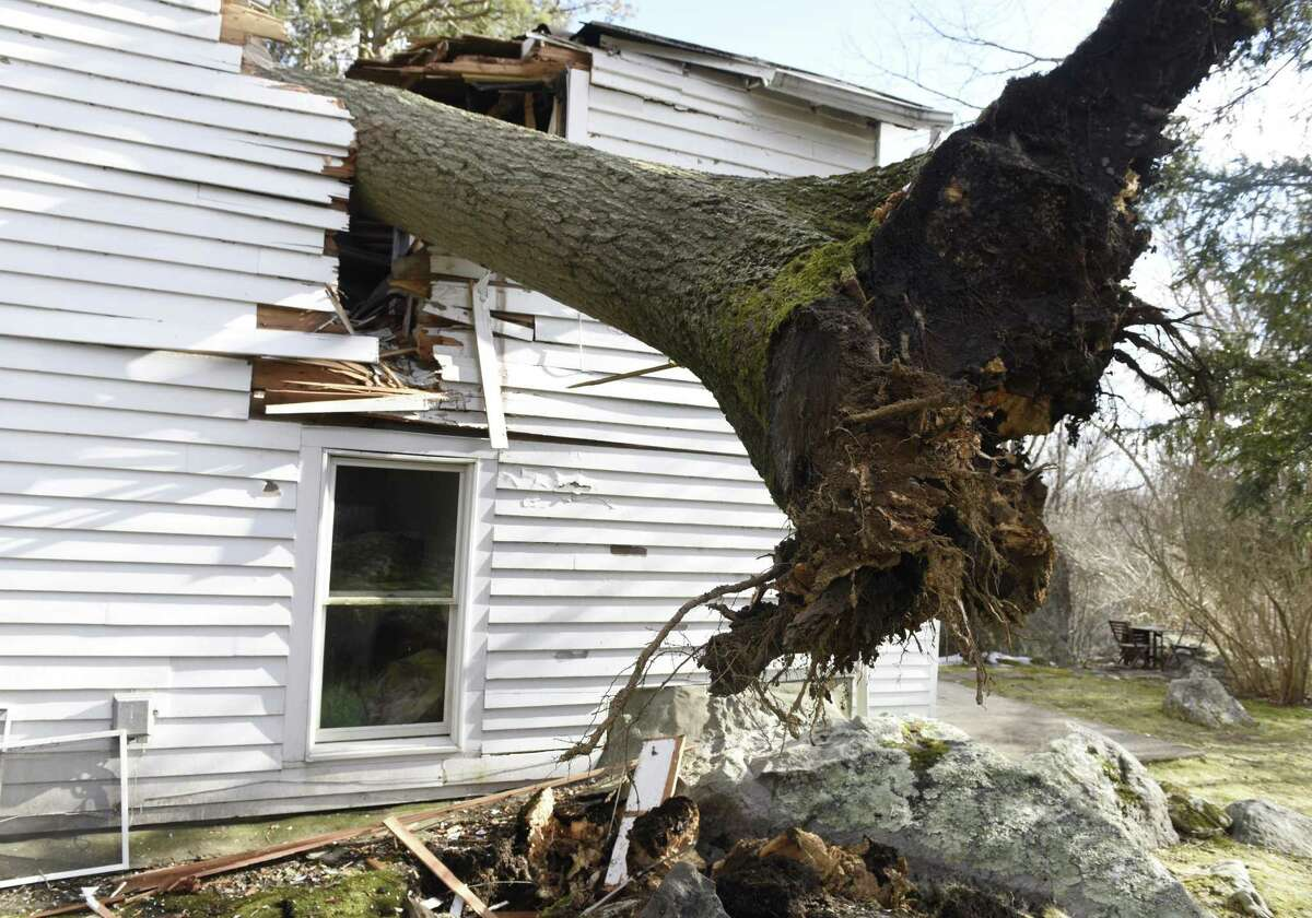A fallen tree destroyed a home at 37 Haviland Ct. in northern Stamford, Conn. Monday, Feb. 25, 2019. The area encountered extremely heavy winds Monday that downed trees causing property damage and closing roads.