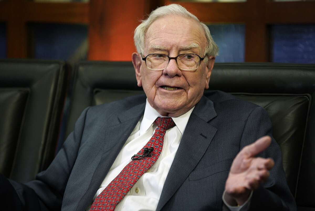 """FILE- In this May 7, 2018, file photo Berkshire Hathaway Chairman and CEO Warren Buffett speaks during an interview in Omaha, Neb., with Liz Claman on Fox Business Network's """"Countdown to the Closing Bell."""" Buffett said Greg Abel and Ajit Jain, the two potential successors he named, earned roughly $18 million last year managing Berkshire Hathaway's dozens of operating companies. Buffett appeared on CNBC Monday, Feb. 25, 2019, after releasing his annual letter to Berkshire shareholders over the weekend. He reiterated Monday that Abel and Jain have both done a great job since they joined Berkshire's board last January. (AP Photo/Nati Harnik, File)"""