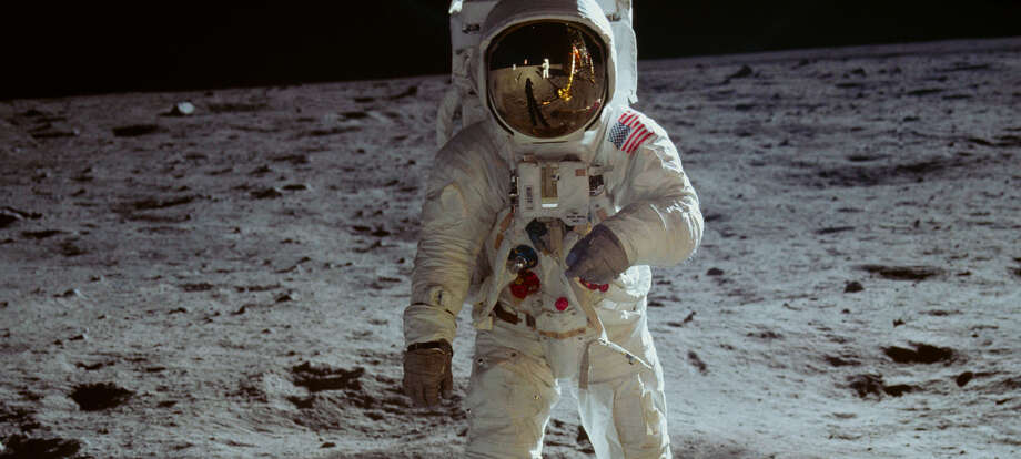 "Buzz Aldrin on the lunar surface in ""Apollo 11."" In Aldrin's visor, you can see the reflection of Aldrin's shadow, the Eagle lander and Neil Armstrong, who was taking the photograph. Photo: Neon/CNN Films / Handout"