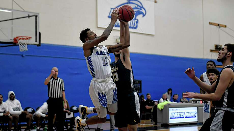 Tyreek Perkins and the Albertus Magnus men's basketball team will open up the Division III NCAA tournament against Christopher Newport on Friday. Photo: Ron Waite / Photosportacular / RON WAITE