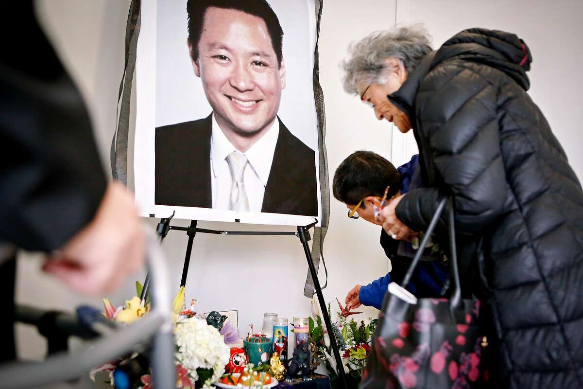 (L to R) Friends Paul Osaki, Teresa Ono, and Marjorie Fletcher pay their respects at a memorial for Jeff Adachi at the San Francisco Public Defender's Office on Monday, February 25, 2019 in San Francisco, Calif.