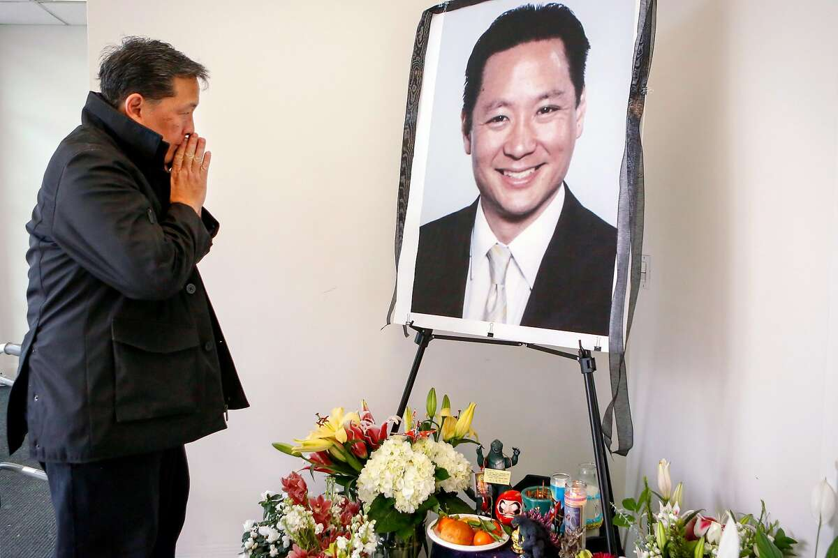 Friend Paul Osaki, director of the Japanese Cultural and Community Center, pays his respects at a memorial for Jeff Adachi at the San Francisco Public Defender's Office on Monday, February 25, 2019 in San Francisco, Calif.