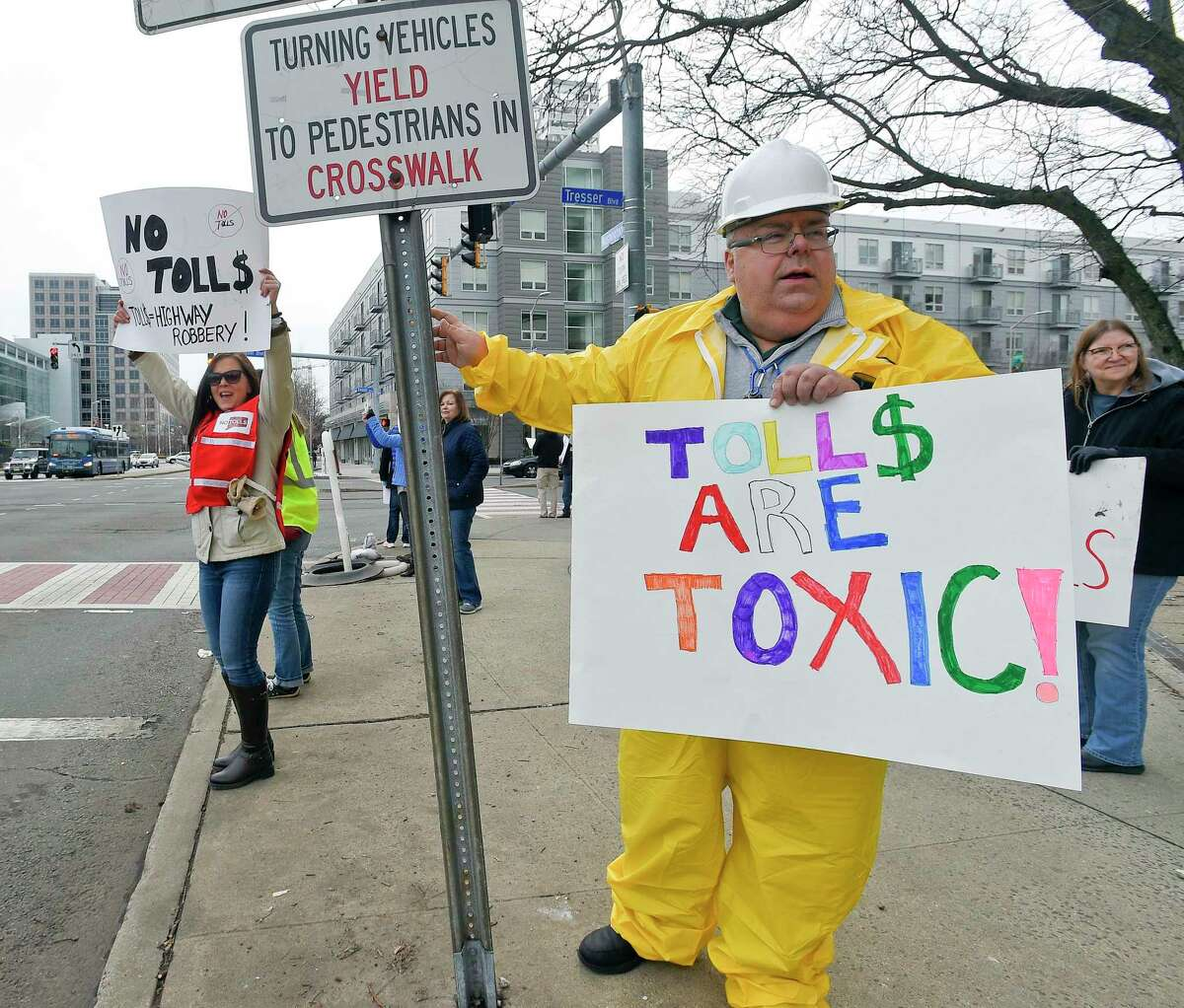 At right, Mike Johnson of New Canaan joins with others from the anti-toll group No Tolls CT, as they stage a protest in front of the Government Center on Feb. 23 in Stamford, Connecticut.