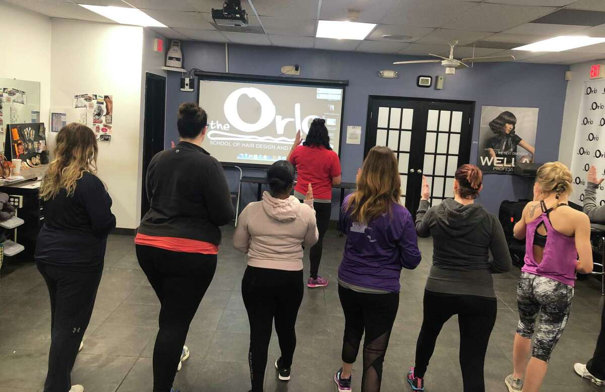 Hair stylists participate in a self defense class, specifically for women in the salon and spa industry, at Orlo School of Hair Design in Albany on Feb. 25, 2019.
