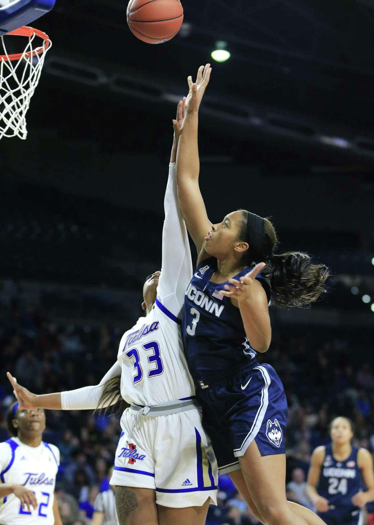 UConn's Megan Walker drives to the basket against Tulsa's Crystal Polk on Sunday. UConn won 68-49.