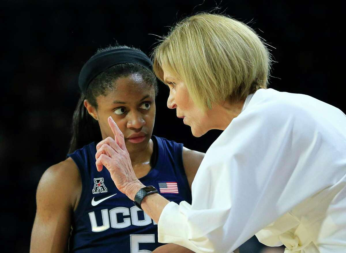 UConn associate head coach Chris Dailey, right, gives instructions to Crystal Dangerfield during a game against Tulsa on Feb. 24. Head coach Geno Auriemma missed the game due to illness.