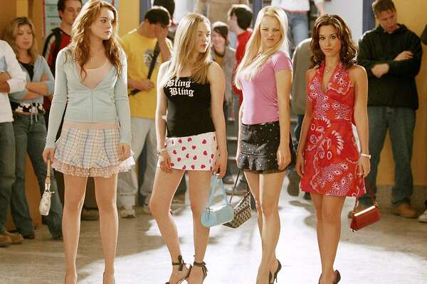 MEAN GIRLS -- (Left to right) Lindsay Lohan as Cady, Amanda Seyfried as Karen, Rachel McAdams as Regina and Lacey Chabert as Gretchen in Mean Girls. (AP Photo/ Michael Gibson)