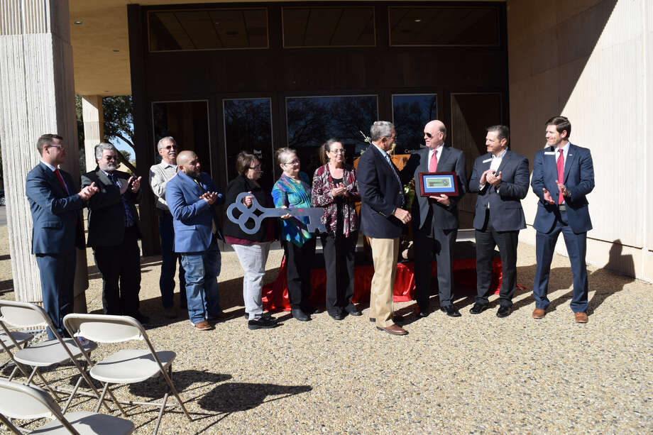 Centennial Bank gifts its old location to the City of Plainview during a dedication/key passing ceremony Thursday afternoon. Photo: Ellysa Harris/Plainview Herald