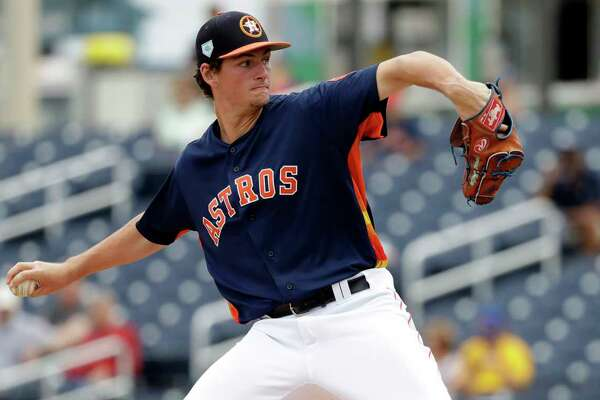 Houston Astros pitcher Forrest Whitley throws during the third inning of an exhibition spring training baseball game against the New York Mets Monday, Feb. 25, 2019, in West Palm Beach, Fla. (AP Photo/Jeff Roberson)