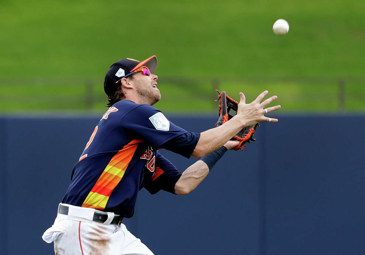 Houston Astros left fielder Josh Reddick catches a fly ball by New York Mets' Jeff McNeil for an out during the fourth inning of an exhibition spring training baseball game Monday, Feb. 25, 2019, in West Palm Beach, Fla. (AP Photo/Jeff Roberson)