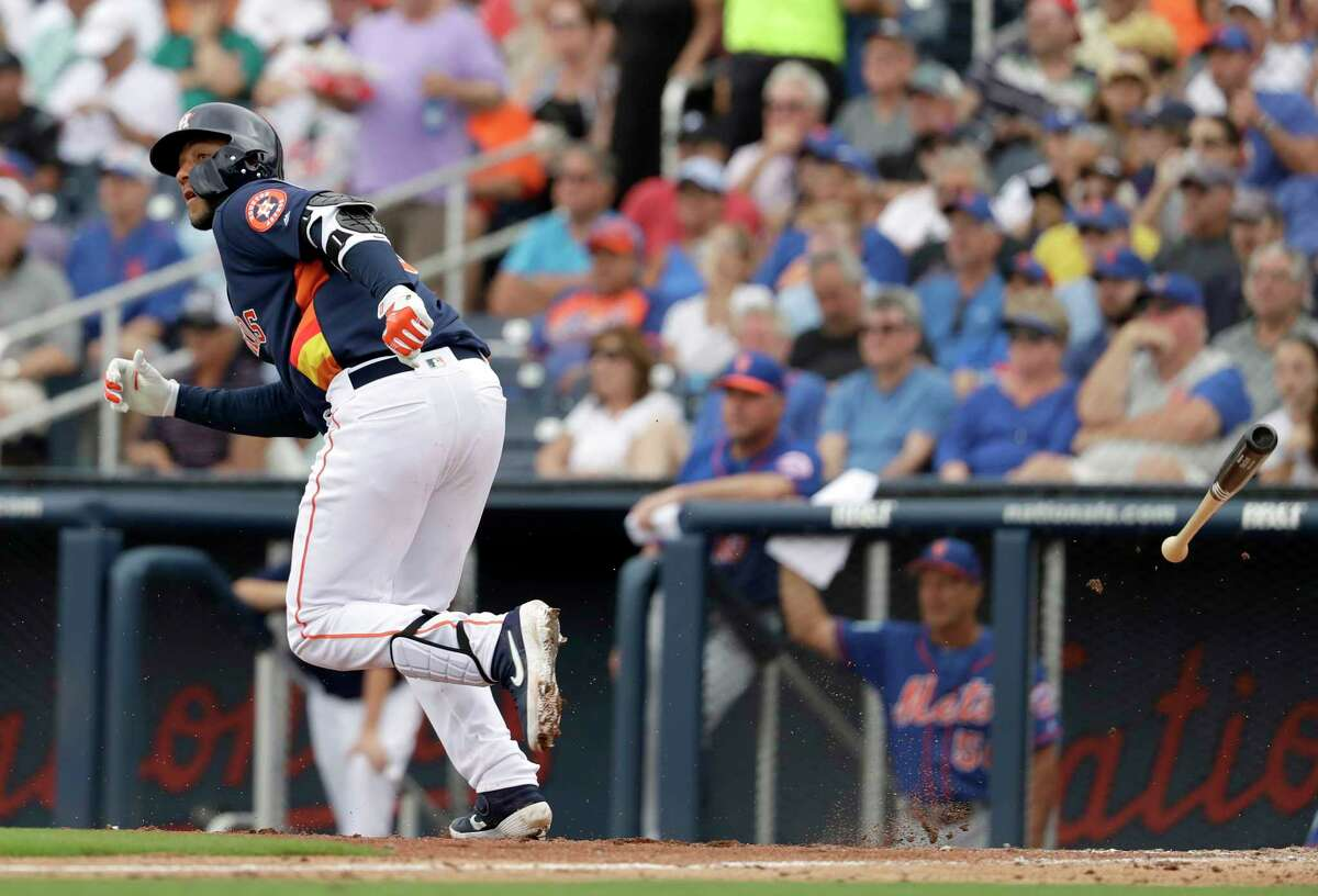 Houston Astros' Yuli Gurriel watches his double during the fifth inning of an exhibition spring training baseball game against the New York Mets Monday, Feb. 25, 2019, in West Palm Beach, Fla. (AP Photo/Jeff Roberson)