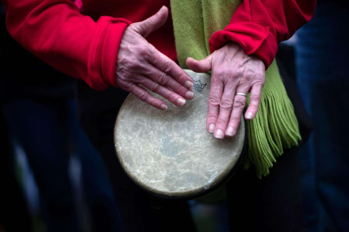 Luis Salazar, a teacher at Melrose Leadership Academy, plays a drum at rally held at Frank Ogawa Plaza on Monday, Feb. 25, 2019, in Oakland, Calif.