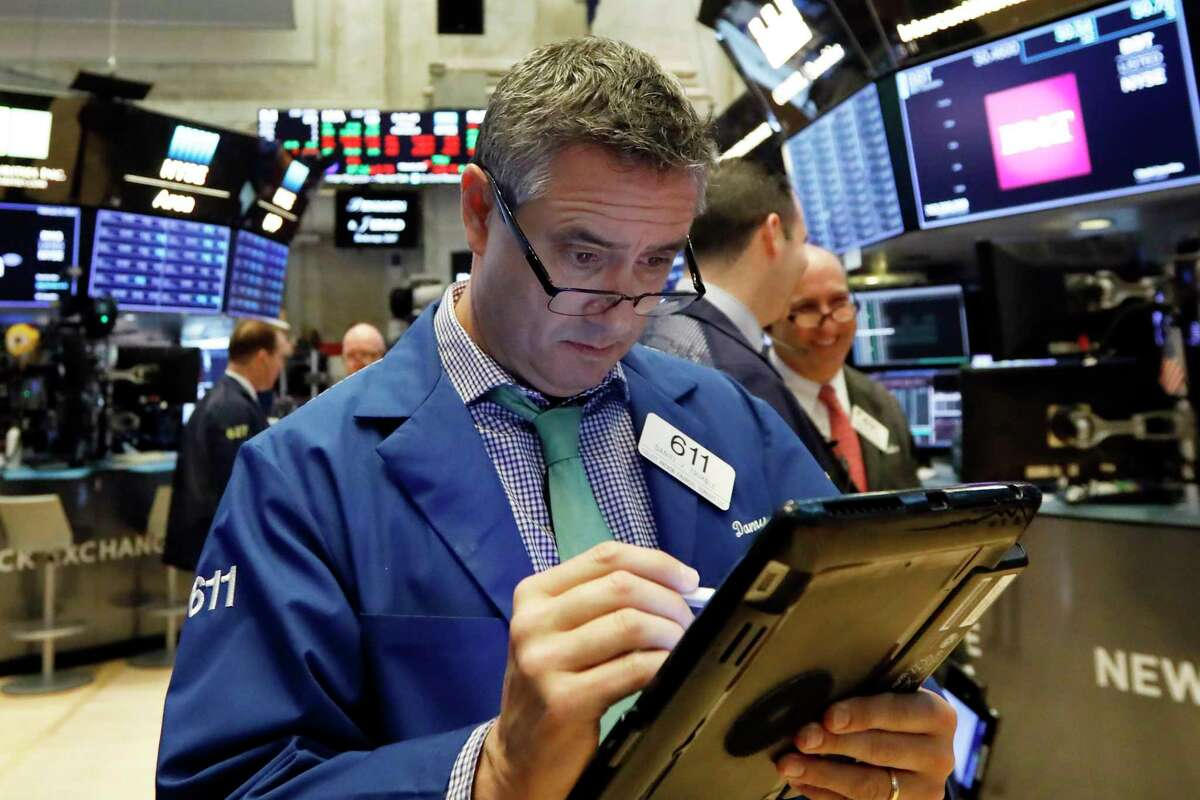 FILE- In this Feb. 8, 2019, file photo trader Daniel Trimble works on the floor of the New York Stock Exchange. The U.S. stock market opens at 9:30 a.m. EST on Monday, Feb. 25. (AP Photo/Richard Drew, File)