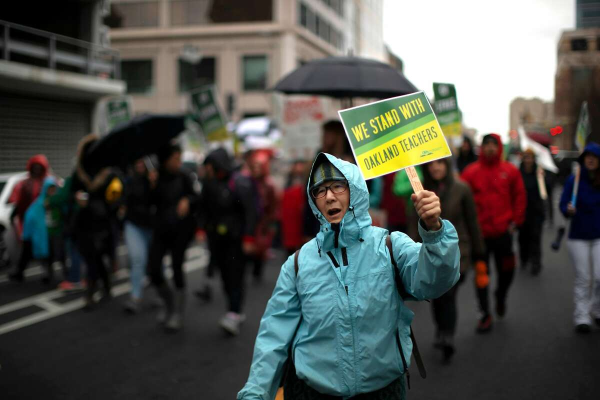 Charlene Kubota, a retired teacher, march from Frank Ogawa Plaza to the Elihu M. Harris State Building on Monday, Feb. 25, 2019, in Oakland, Calif.