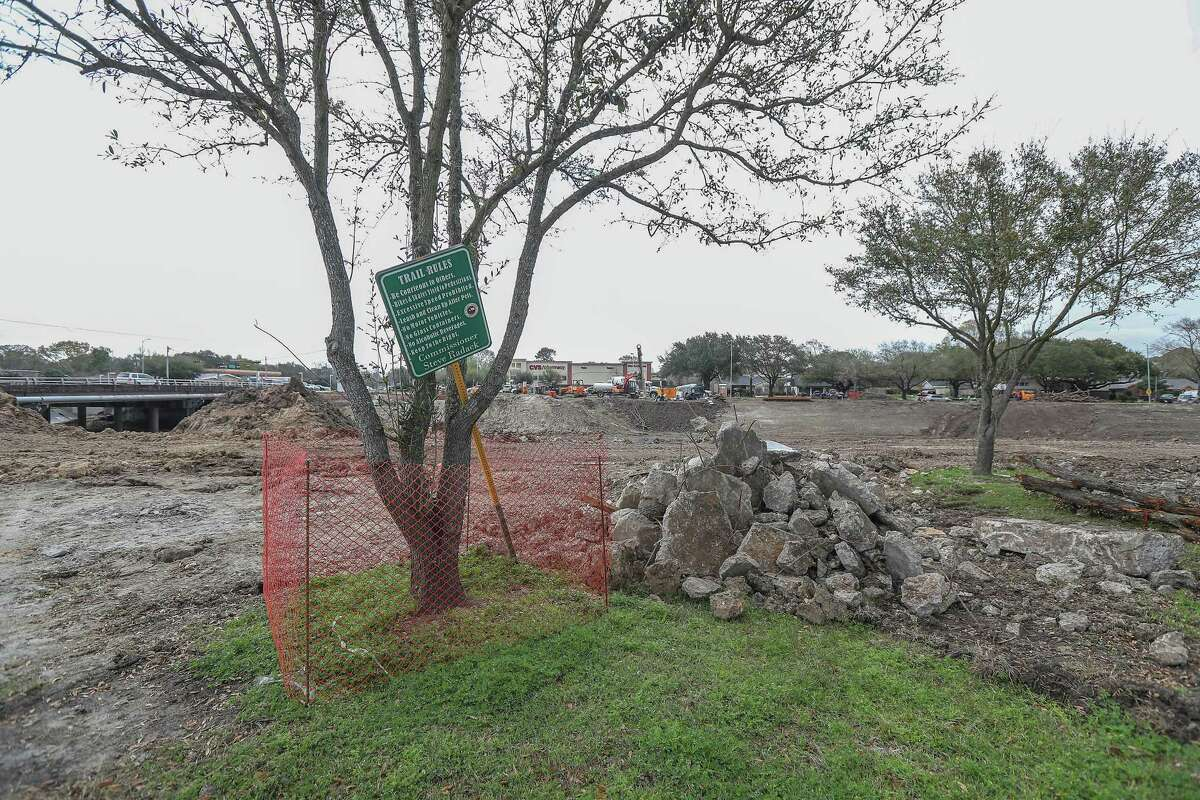Work continues on Brays Bayou at Hillcroft Ave and Braeswood Blvd causing the trail to be closed Monday, Feb. 25, 2019, in Houston. Residents along Brays Bayou are upset over possible new delays, caused by utility lines and traffic concerns, to Harris County Flood Control District work on bridges over the waterway.