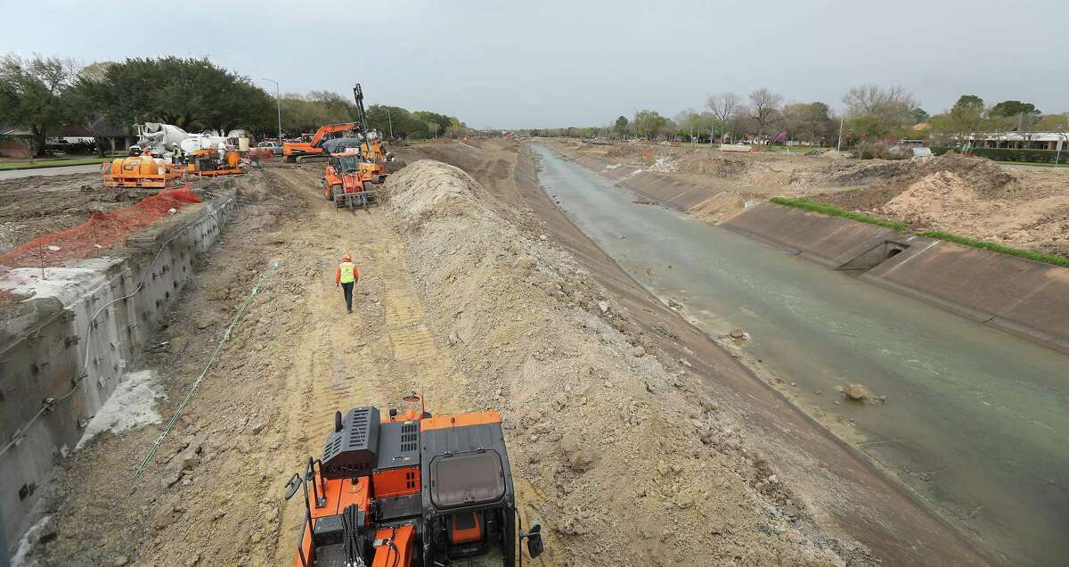 Work continues on Brays Bayou at Hillcroft Ave and Braeswood Blvd Monday, Feb. 25, 2019, in Houston. Residents along Brays Bayou are upset over possible new delays, caused by utility lines and traffic concerns, to Harris County Flood Control District work on bridges over the waterway.