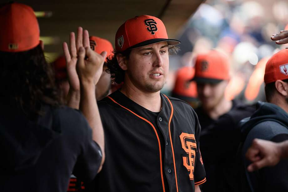 SCOTTSDALE, ARIZONA - FEBRUARY 25: Derek Holland #45 of the San Francisco Giants is congratulated in the dugout after being relieved during the second inning of the spring training game against the Chicago White Sox at Scottsdale Stadium on February 25, 2019 in Scottsdale, Arizona. (Photo by Jennifer Stewart/Getty Images) Photo: Jennifer Stewart / Getty Images