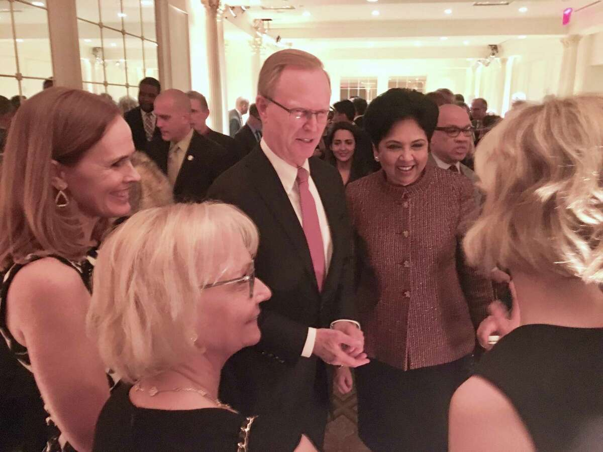 New York Giants owner John Mara talking with PepsiCo CEO Indra K. Nooyi at the Sandy Hook Promise benefit in New York in December 2017. At foreground is Mara's wife, Denise. Nooyi, a member of Gov. Ned Lamont's economic development team, has been named to the board of Amazon.