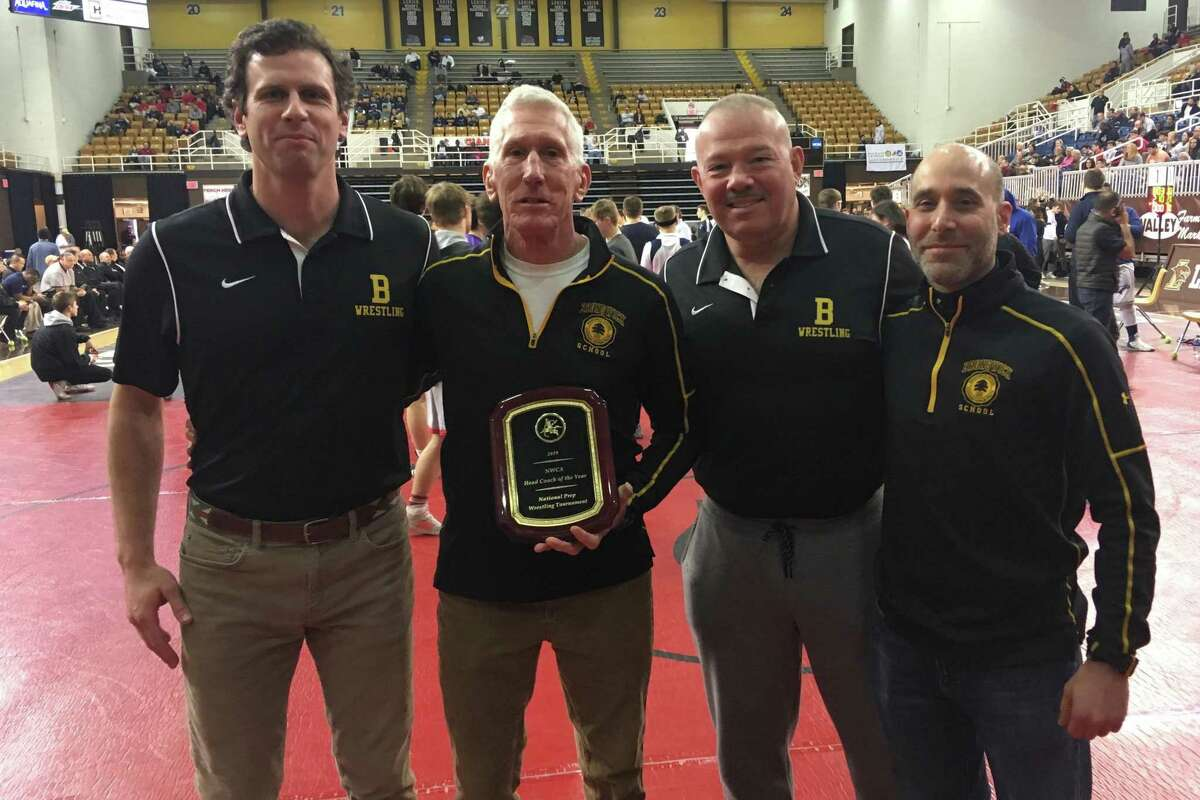 Brunswick School wrestling coach Tim Ostrye, center, was selected as the National Coach of the Year at the National Prep School Wrestling Championships on Saturday at Lehigh University in Bethlehem, Pa. Pictured with Ostrye are assistant coaches, John Martin, left and Bob Benjamin and Neil Minsky, right.