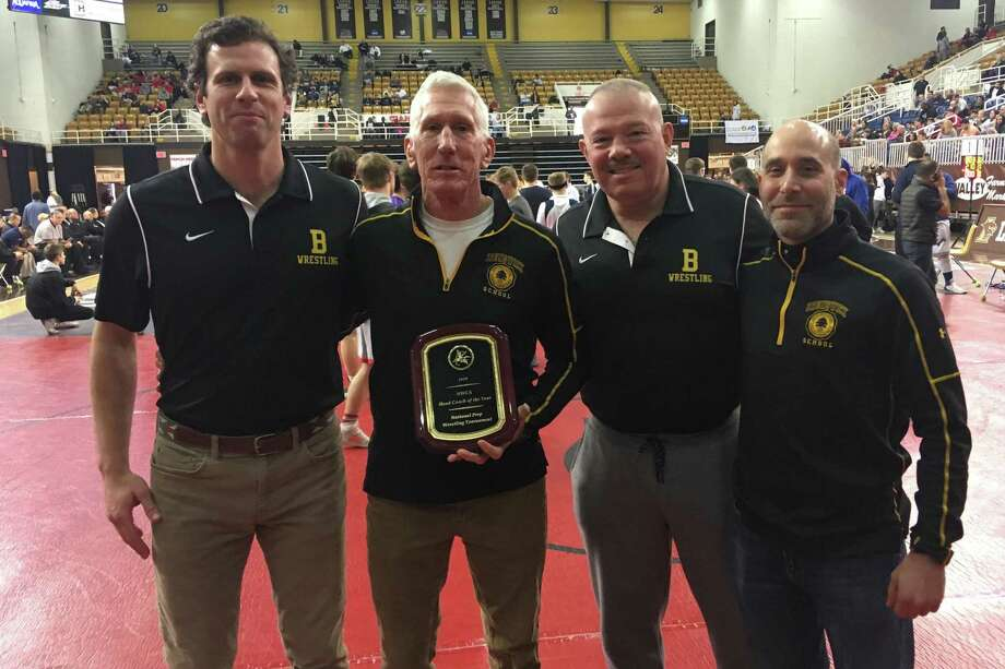 Brunswick School wrestling coach Tim Ostrye, center, was selected as the National Coach of the Year at the National Prep School Wrestling Championships on Saturday at Lehigh University in Bethlehem, Pa. Pictured with Ostrye are assistant coaches, John Martin, left and Bob Benjamin and Neil Minsky, right. Photo: Contributed Photo / Greenwich Time Contributed