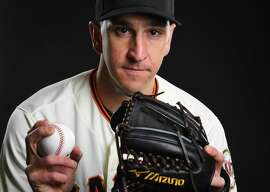 Pat Venditte #46 of the San Francisco Giants poses during the Giants Photo Day on February 21, 2019 in Scottsdale, Arizona. (Photo by Jamie Schwaberow/Getty Images)