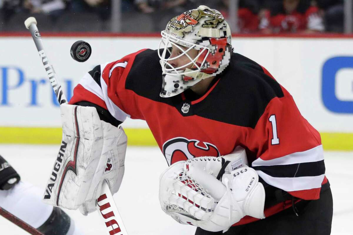 New Jersey Devils goaltender Keith Kinkaid (1) makes a save against the Los Angeles Kings during the first period of an NHL hockey game Tuesday, Feb. 5, 2019, in Newark, N.J. (AP Photo/Julio Cortez)