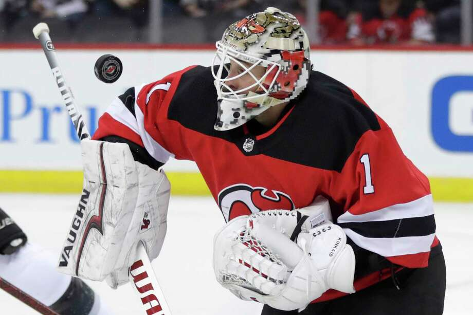 New Jersey Devils goaltender Keith Kinkaid (1) makes a save against the Los  Angeles b6eab9d7b
