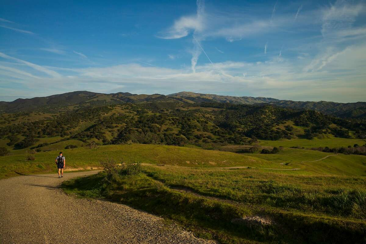 A man walks down a trail at Fort Ord National Monument in Monterey County, Calif.