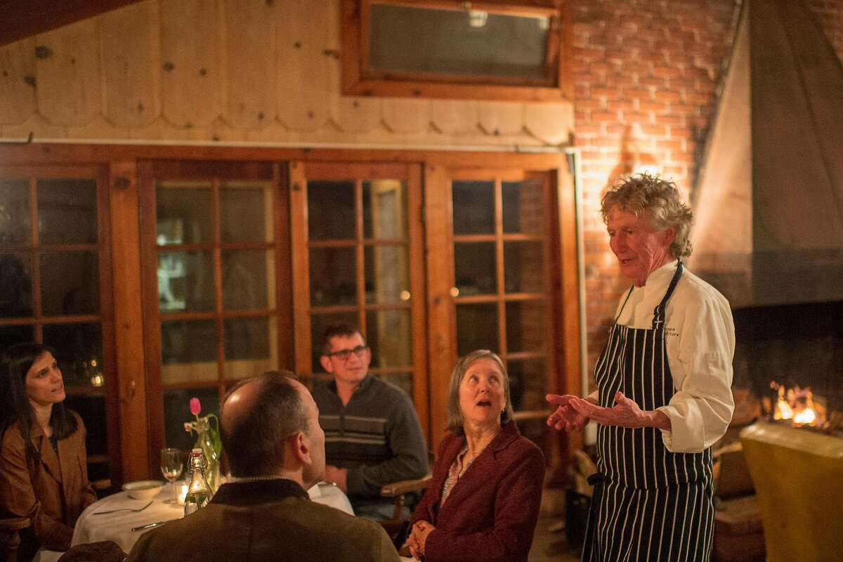 chef Michael Jones talks with guests during a pop-up dinner at Douglas Ranch in Carmel Valley, Calif.