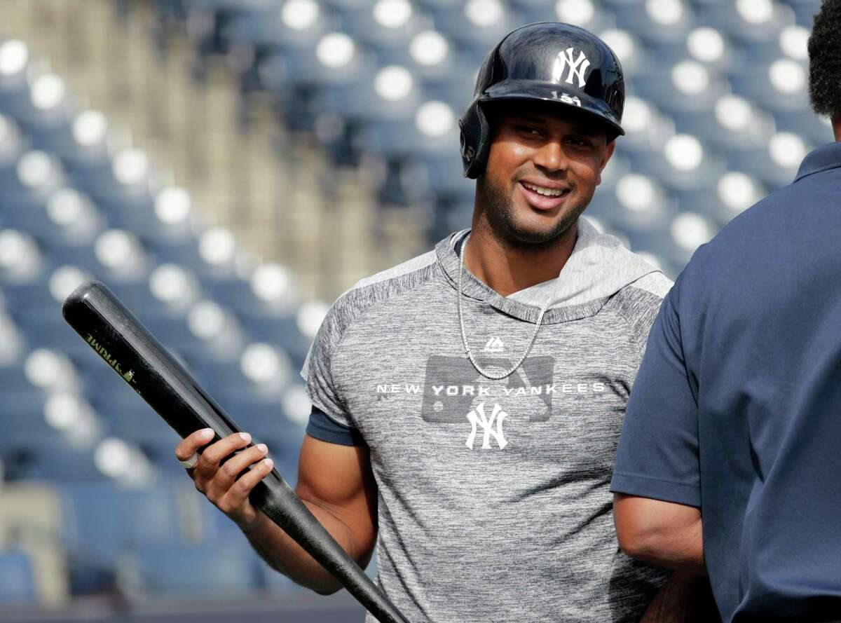New York Yankees' Aaron Hicks smiles as he takes batting practice before a spring training baseball game against the Toronto Blue Jays, Monday, Feb. 25, 2019, in Tampa, Fla. The Yankees announced that Hicks signed a seven-year contract Monday. (AP Photo/Lynne Sladky)