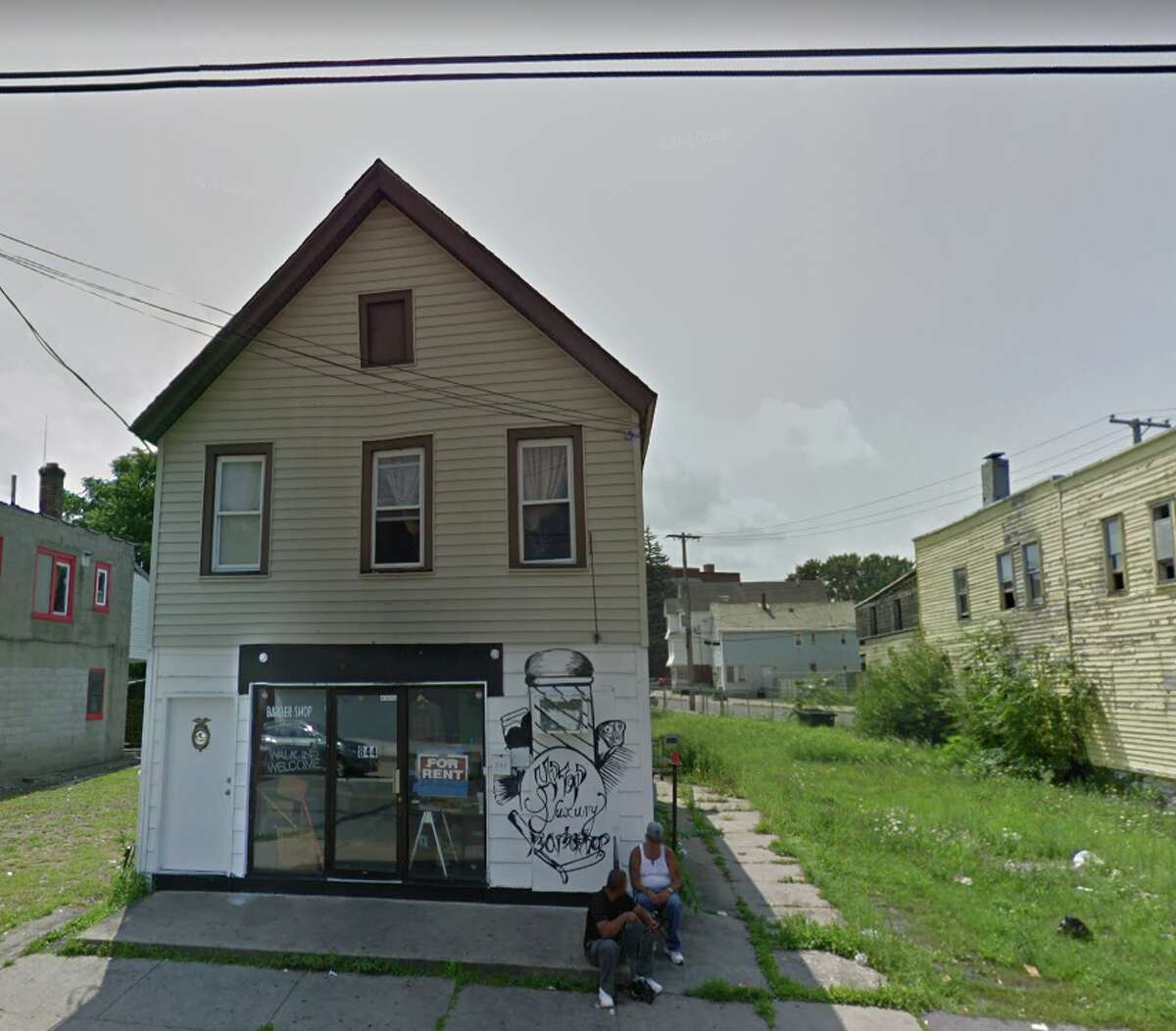 Hamilton Hill residents oppose plans to open a wine and liquor in this former barber shop at 844 Albany St. in Schenectady, N.Y., shown here in an August 2018 Google StreetView photo.