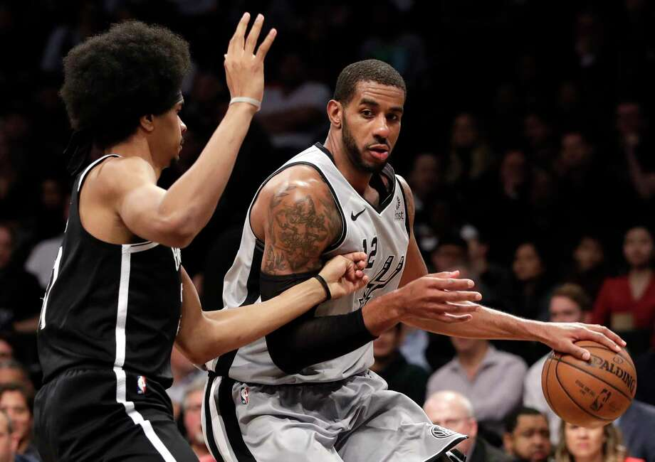San Antonio Spurs center LaMarcus Aldridge (12) drives up against Brooklyn Nets center Jarrett Allen (31) during the first half of an NBA basketball game, Monday, Feb. 25, 2019, in New York. (AP Photo/Kathy Willens) Photo: Kathy Willens, Associated Press / Copyright 2019 The Associated Press. All rights reserved.