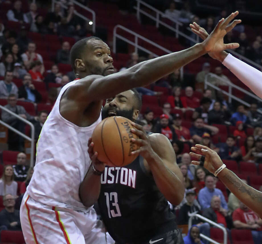 432c5d3698c7 Atlanta Hawks center Dewayne Dedmon (14) stopped Houston Rockets guard James  Harden (13
