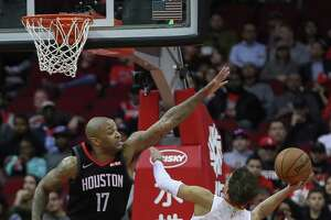 Houston Rockets forward PJ Tucker (17) could stop Atlanta Hawks guard Trae Young (11) from scoring during the first half of an NBA basketball game at Toyota Center on Monday, Feb. 25, 2019, in Houston.