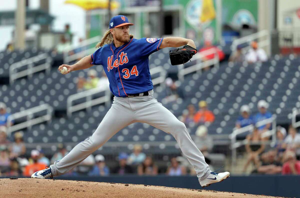 New York Mets starting pitcher Noah Syndergaard throws during the first inning of an exhibition spring training baseball game against the Houston Astros Monday, Feb. 25, 2019, in West Palm Beach, Fla. (AP Photo/Jeff Roberson)