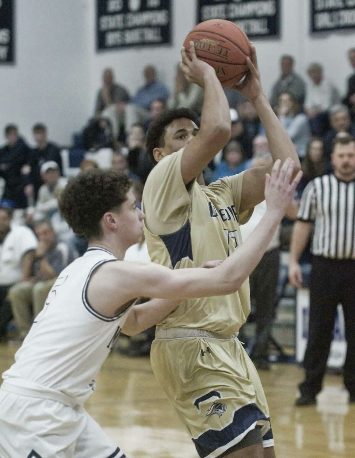 Notre Dame-Fairfield High School's Derek Long tries to get off a shot in the SWC boys basketball tournament semifinal against Immaculate High School, played at Immaculate. Monday, Feb. 25, 2019