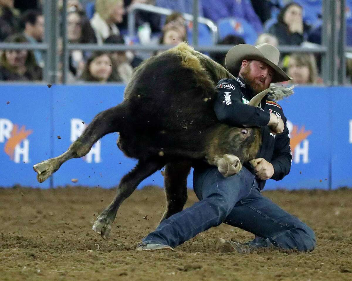 Clayton Hass competes during the Steer Wrestling event in round 1 of the Super Series I during the Houston Livestock Show and Rodeo at NRG Stadium, Monday, Feb. 25, 2019, in Houston.