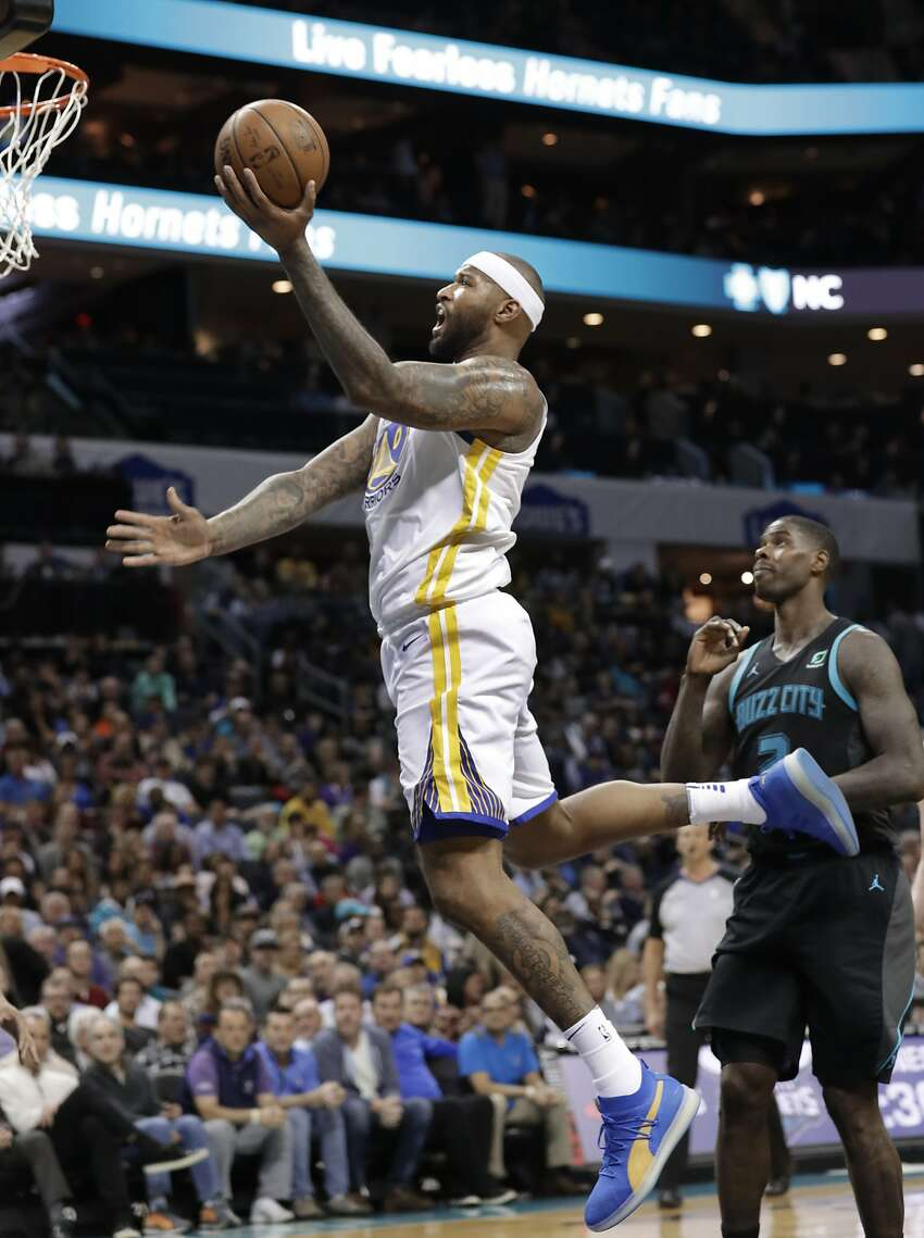 Golden State Warriors' DeMarcus Cousins (0) drives past Charlotte Hornets' Marvin Williams (2) during the second half of an NBA basketball game in Charlotte, N.C., Monday, Feb. 25, 2019. (AP Photo/Chuck Burton)