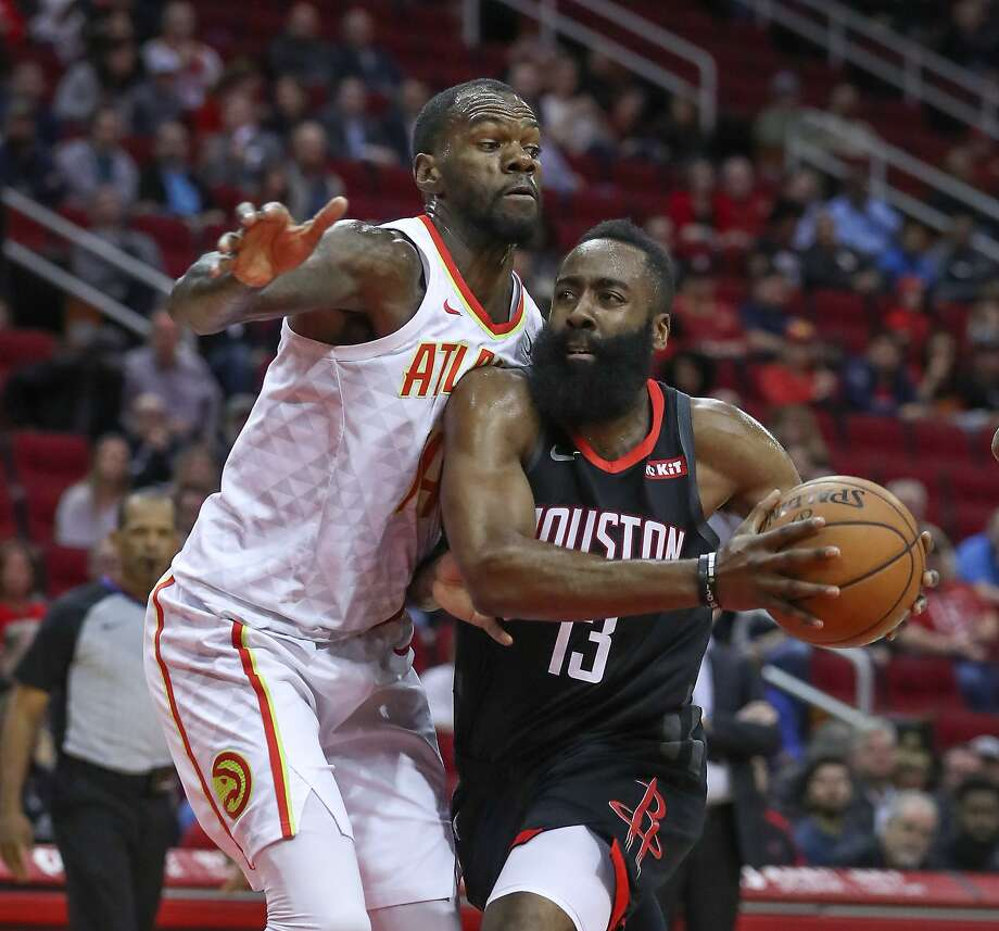 Atlanta Hawks center Dewayne Dedmon (14) attempts to stop Houston Rockets guard James Harden (13) from driving to the basket during the first half of an NBA basketball game at Toyota Center on Monday, Feb. 25, 2019, in Houston. Photo: Steve Gonzales, Houston Chronicle / Staff Photographer / © 2019 Houston Chronicle