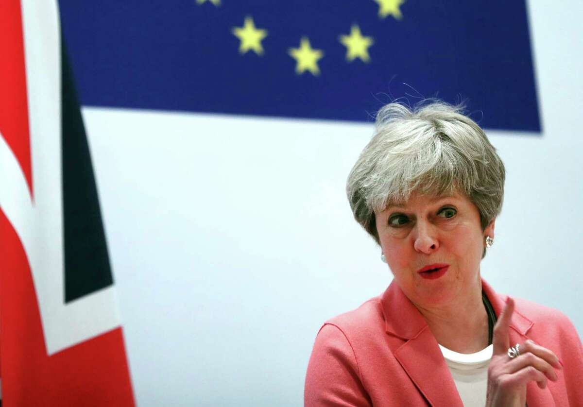 British Prime Minister Theresa May speaks during a media conference at the conclusion of an EU-Arab League summit at the Sharm El Sheikh convention center in Sharm El Sheikh, Egypt, Monday, Feb. 25, 2019. British Prime Minister Theresa May stays convinced that March 29 remains a realistic Brexit date, despite the EU urging Britain to delay its departure from the bloc to avoid a chaotic rupture. (AP Photo/Francisco Seco)