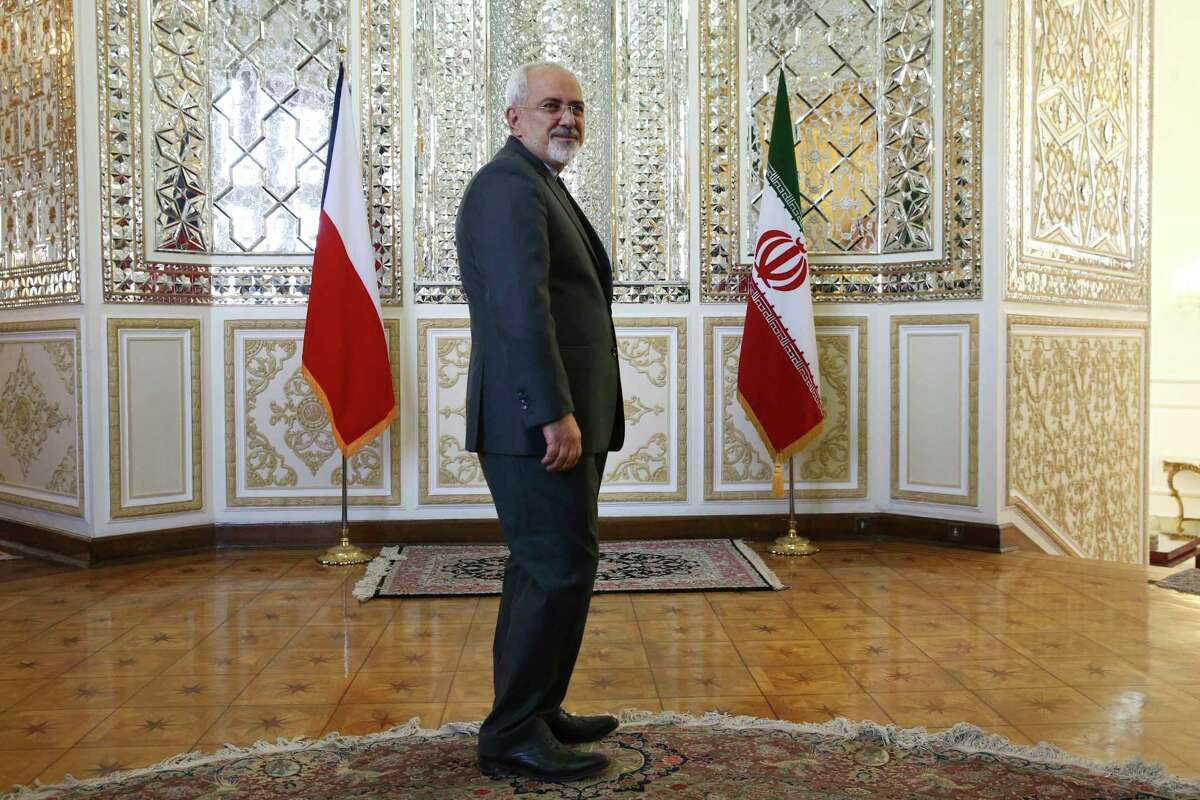FILE- In this Sept. 6, 2015, file photo, Iranian Foreign Minister Mohammad Javad Zarif stands prior to a meeting in Tehran, Iran. On Monday Feb. 25, 2019, Iran's state-run IRNA news agency reported that Foreign Minister Mohammad Javad Zarif has resigned. (AP Photo/Vahid Salemi, File)