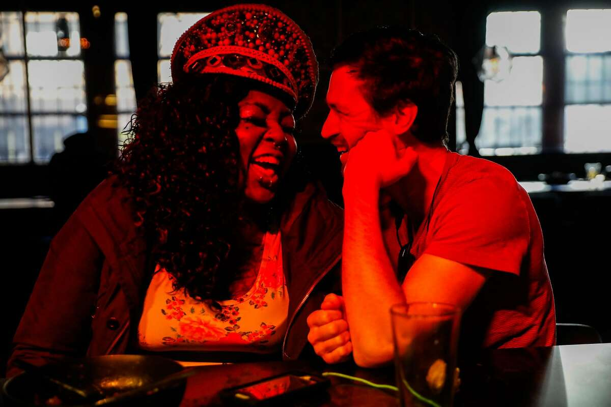 Sgt. Die Wies (left) laughs with a friend while having a drink at Jolene's bar in San Francisco, California, on Sunday, Feb. 17, 2019.