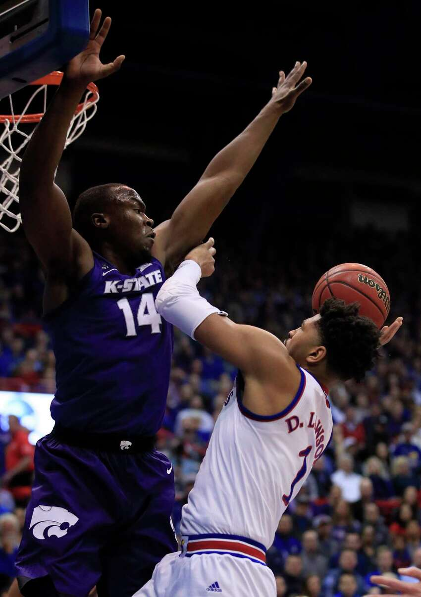 Kansas forward Dedric Lawson (1) shoots over Kansas State forward Makol Mawien (14) during the first half of an NCAA college basketball game in Lawrence, Kan., Monday, Feb. 25, 2019. (AP Photo/Orlin Wagner)