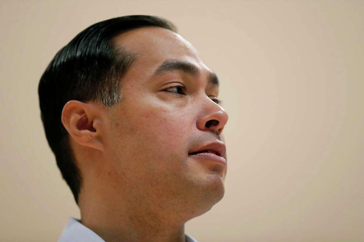 In this Feb. 21, 2019, photo, Julian Castro, former U.S. Secretary of Housing and Urban Development, and candidate for the 2020 Democratic presidential nomination, speaks during a town hall meeting at Grand View University in Des Moines, Iowa. Several Democratic presidential candidates are embracing reparations for the descendants of slaves _ but not in the traditional sense. Over the past week, Senators Kamala Harris, Elizabeth Warren and former Obama cabinet secretary Castro spoke of the need for the U.S. government to reckon with and make up for slavery. But instead of backing the direct compensation for African-Americans, they are talking about more universal policies that would also benefit blacks. (AP Photo/Charlie Neibergall)