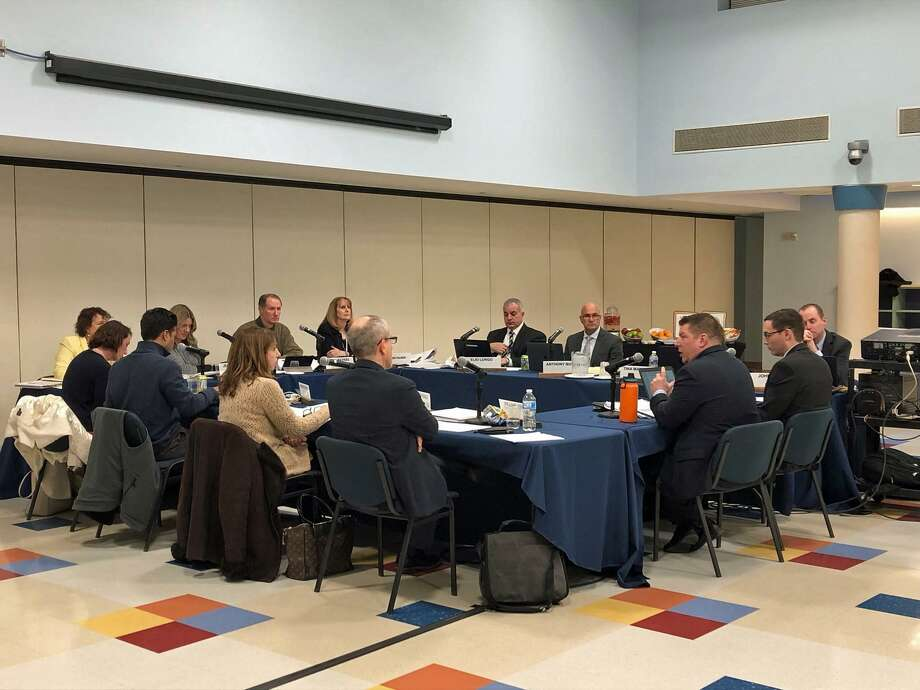 The Board of Education discusses enrollment projections and redistributing scenario options with planning consultant Mike Zuba at its meeting on Feb. 25, 2019, in Westport. Photo: Sophie Vaughan / Hearst Connecticut Media /