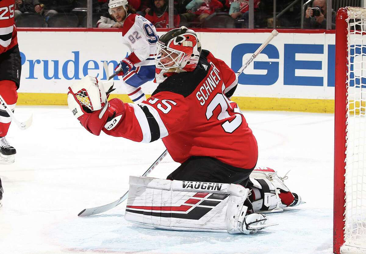 NEWARK, NEW JERSEY - FEBRUARY 25: Cory Schneider #35 of the New Jersey Devils makes a save against the Montreal Canadiens during their game at Prudential Center on February 25, 2019 in Newark, New Jersey. (Photo by Al Bello/Getty Images)