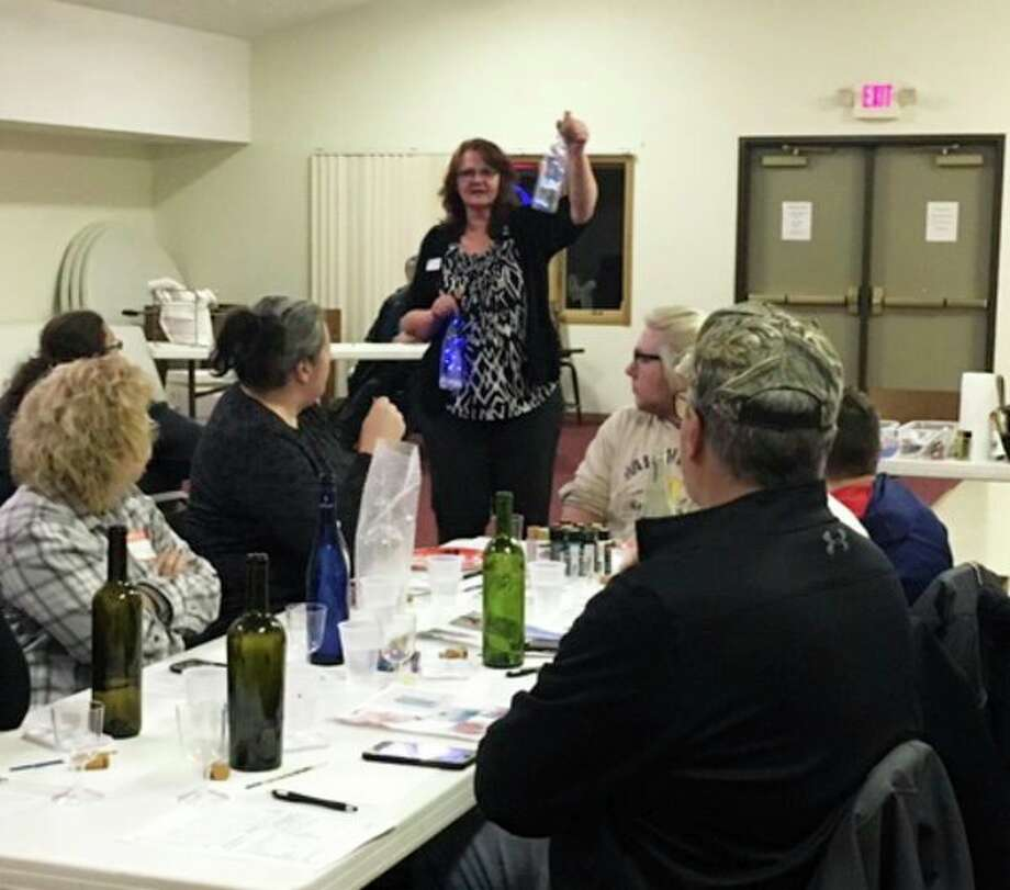 A group of pet lovers recently gathered to support The Humane Society of Midland County while enjoying a painting and wine-tasting event. (Photo provided/HSOMC)