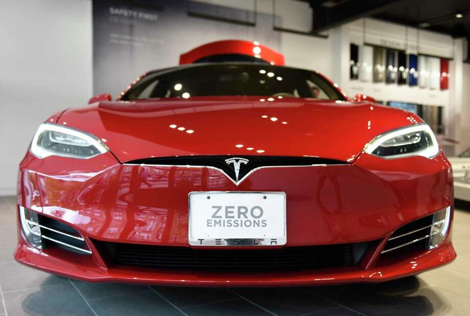 The Model S sedan at the new Tesla gallery on Greenwich Avenue in Greenwich, Conn. Wednesday, Sept. 28, 2016. The gallery displays Tesla's Model S sedan and Model X SUV-crossover, as well as the company's unique battery-lined rolling chassis. Tesla cannot currently sell cars in Connecticut thanks to state franchise laws which prohibit the direct sale of vehicles by auto manufacturers, so the space is used to educate the public about Tesla and the advancement in electric vehicle technology. The gallery opens to a private audience of Connecticut Tesla owners and town leaders Thursday, Oct. 6 and will open to the public Friday, Oct. 7. Photo: Tyler Sizemore / Hearst Connecticut Media / Greenwich Time